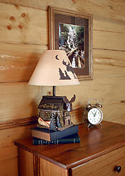 Our 2 story log cabin is decorated with a hiking camping theme and photographs of some of the local waterfalls
